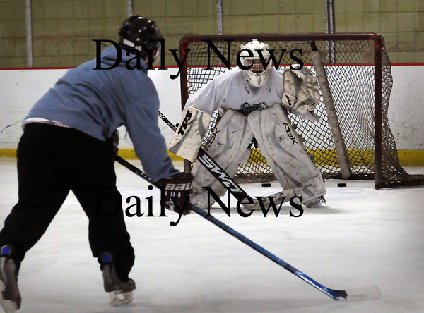 Newburyport: Newburyport High hockey goalie Anthony Frederico takes shots during practice last night. Bryan Eaton/Staff Photo