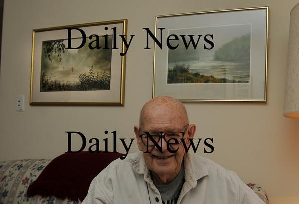 Newburyport: John Grepp in his apartment at Atria Merrimack beneath some of his works. Bryan Eaton/Staff Photo