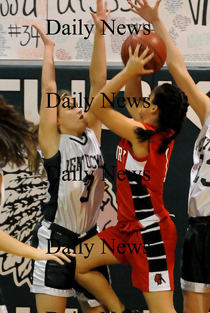 West Newbury: Pentucket's Emily Lane, left, defends a shot by Amesbury's Kerri Salvatore. Bryan Eaton/Staff Photo