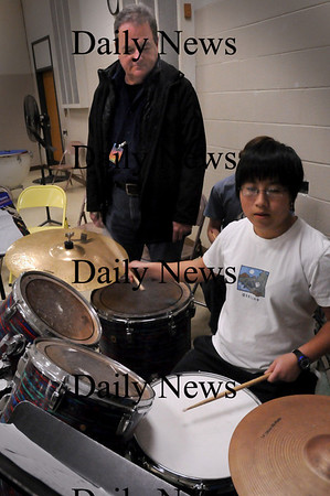 Newburyport: Danny Harrington's daughter, Nina, 8, is a drummer with the Nock Middle School's Jazz Band which he's volunteering his time to. Bryan Eaton/Staff Photo