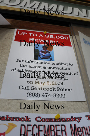 Seabrook: Posters offering a reward for people that may be involved in the death of John Allen Eaton, Jr. are posted around Seabrook, here on the community board at the northern Market Basket. Bryan Eaton/Staff Photo