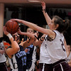 Newburyport: Newburyport's Samantha Baribeault puts pressure on Triton's Maxine Crossley last night at Newburyport High. Bryan Eaton/Staff Photo