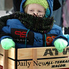 Amesbury: Harold Brogan, 3, is bundled from the cold in Amesbury's Upper Millyard as he watches Amesbury Elementary School students sing holiday carols. His sister Violette, 7, was one of the students doing the singing Monday afternoon for relatives to hear. Bryan Eaton/Staff Photo