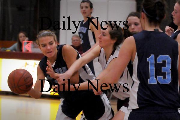 Newburyport: Triton's Jen Rock looks to throw past Newburyport defender Samantha Baribeault in Newburyport. Bryan Eaton/Staff Photo