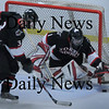 Newburyport: North Andover goalie Tyler Morandi moves on a Newburyport shot at the net Saturday night at the Graf Rink. Bryan Eaton/Staff Photo