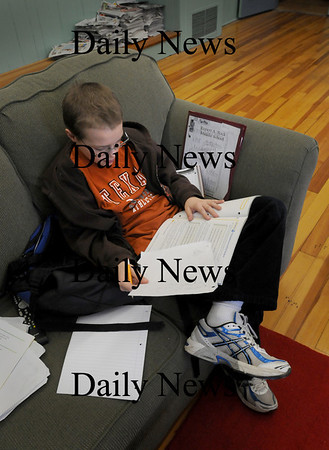 Newburyport: Mondays are kind of quiet the Kelley School Youth Center in Newburyport which suited David Reed, 12, just fine as he worked on some math homework, though his favorite subject is science. Bryan Eaton/Staff Photo