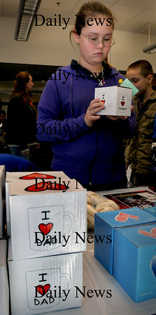 Salisbury: Sabryn Eaton, 11, checks out the various items for sale at the Holiday Shop at Salisbury Elementary School on Monday morning. The money raised goes to the school's PTA to fund various events throughout the year. Bryan Eaton/Staff Photo
