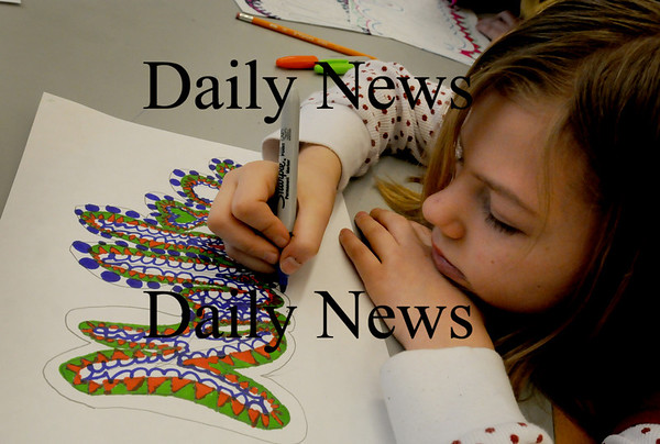 Salisbury: Hallie Livengood, 10, writes her name using abstract art techniques that she's learning in Amy Merluzzi's art class at Salisbury Elementary School on Tuesday afternoon. Bryan Eaton/Staff Photo