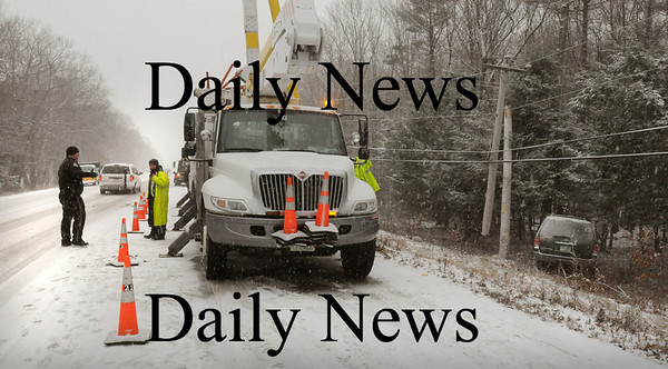 Seabrook: Two young women were uninjured when their vehicle slid of Route 286 eastbound in Seabrook cutting this telephone pole in half. Power was out in some parts of town until utility crews repaired the damage during the snowy weather. Bryan Eaton/Staff Photo