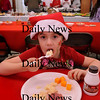Seabrook: Ashleigh Trimarco, 8, digs into her matched potatoes as volunteers in back dish out food at the Gift of Giving Christmas Meal at Passaconaway Hall in Seabrook on Christmas Eve. Bryan Eaton/Staff Photo