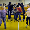Amesbury: Children participate in the Virginia Reel dance, similar to square-dancing in gym class at Amesbury's Cashman School on Thursday morning. Physical education teacher Ted Flaherty teaches different dances during the month of December and music teacher Kathleen Daley thought it would be good to combine her music classes into the events. Bryan Eaton/Staff Photo