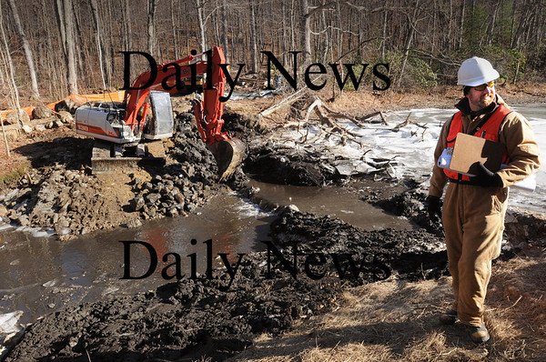 Rowley: Alex Hackman, a restoration specialist for the state Division of Ecological Restoration, is overseeing the demolition of a century-old damn  on the Ox Pasture Creek off Central Street in Rowley. Bryan Eaton/Staff Photo
