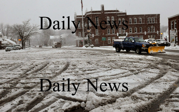Merrimac: Western parts of the lower Merrimack Valley recieved a good amount of snow during the storm yesterday, like here in downtown Merrimac, while the coast received lots of rain and wind. Bryan Eaton/Staff Photo