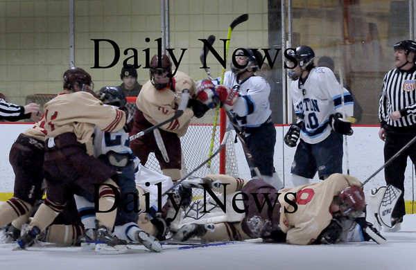 Newburyport: Newburyport and Triton hockey teams scuffle with a couple minutes left of the first period. Bryan Eaton/Staff Photo