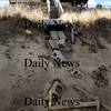 Newbury: Wednesday's storm cleaned away the bottom steps from the landmark Bennett Hill cottage, just to the south of the parking lot at Plum Island Center. One of the stringers of which was caught up on the rock berm along with other logs and debris. Bryan Eaton/Staff Photo