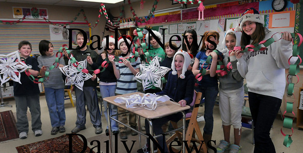 Newburyport: Nock Middle School students made garland and white snowflakes to be used for a party for senior citizens the week of Christmas. Bryan Eaton Photo