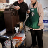 Amesbury: Volunteer Bob Comeau, left, and retiring Our Neighbor's Table Director Rosemay Werner prepare a hot coffee station for people while waiting for the food pantry to begin yesterday afternoon. Bryan Eaton/Staff Photo