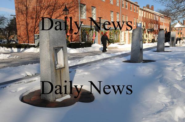 Newburyport: Many of the granite lightposts on Inn Street haven't been working for years. Bryan Eaton/Staff Photo.