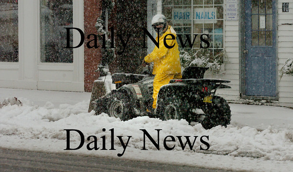 Merrimac: Harold White of the Merrimac Highway Department clears off sidewalks in the town center yesterday morning during the snowstorm, which was mostly rain along the coast. Bryan Eaton/Staff Photo