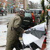 Newburyport: This man's umbrella was no match for the high winds that blew through the area Wednesday, as it was turned inside out by a gust while crossing State Street in Newburyport. Photo by Ben Laing/Staff Photo