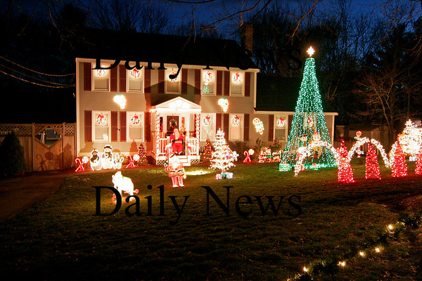 Amesbury: The annual Christmas light show at the Edmands' home on Old Country Road in Amesbury continues to raise money and gifts for the Toys For Tots program. The show runs every night at 7pm. Photo by Ben Laing/Staff Photo