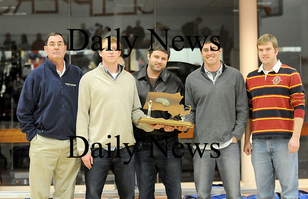 Newburyport: Members of the 1999-2000 Clippers boys basketball team, which won the state championship, presented the school with a trophy during halftime of Wednesday nights game. From left, Coach Kevin Lucy, Harley Davis, Sean Sullivan, Ben Babcock, and Chris Sheehan. Photo by Ben Laing/Staff Photo
