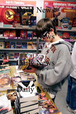 Amesbury: Eight grader, Nick Kidd, of Amesbury Middle School, thumbs through a 3D book at the schools book fair Tuesday morning. Photo by Ben Laing/Staff Photo