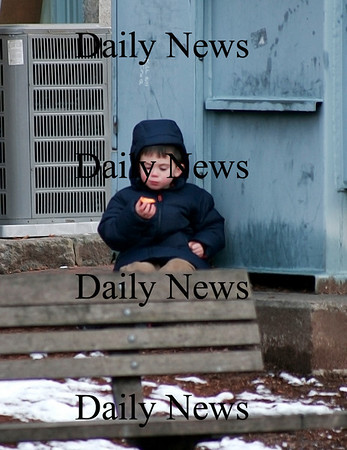 Newburyport: Llew Worden, 4, of Newburyport, snacks on a treat near the tot lot on Inn Street in Newburyport while spending Tuesday afternoon downtown with his dad. Photo by Ben Laing/Staff Photo