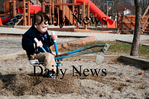 Amesbury: Maddox Burrill, 2, of Amesbury, digs in the sandbox at the Amesbury Town Park Wednesday morning. Temperatures in the area were near 50 degrees, making the playground a popular spot for parents and children. Photo by Ben Laing/Staff Photo
