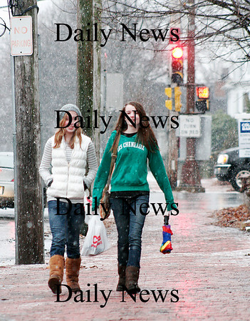 Newburyport: Izzie Davies, left, and Erica Reusse, both 15 of Newburyport, get caught in a snow squall on their walk downtown Monday afternoon. Photo by Ben Laing/Staff Photo