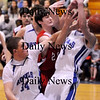 Georgetown: Chris Esposito (34) and another Georgetown player battle with Amesbury's Tyler Lay (20) for a rebound during Monday night's double header at Georgetown High. The game was part of the inaugural River Rival Basketball Festival at Georgetown High.