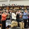 Byfield: Parents and students give Susan Densmore, seated, a standing ovation after her remarks to the Triton School Commitee Tuesday night. Photo by Ben Laing/Staff Photo