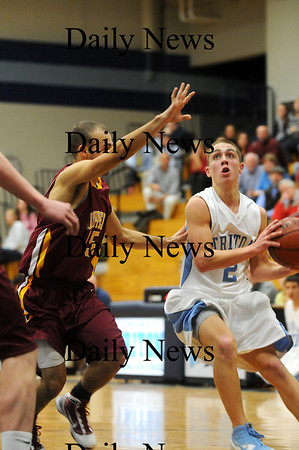 Byfield: Triton's Jedd Hutchins (2) looks to put up a shot against Newburyport's DJ Grabowski (15) during Tuesday night's game in Byfield. Photo by Ben Laing/Staff Photo