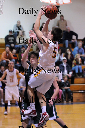 Georgetown: Newburyport's Chris Jayne (5) takes a jump shot during Monday night's opening game of the inaugural River Rival Basketball Festival at Georgetown High. The Clippers would lose to Pentucket in the opening game. Photo by Ben Laing/Staff Photo