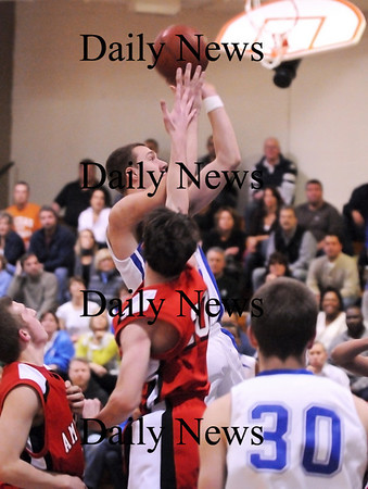 Georgetown: Mike Messman of Georgetown rises above the Amesbury defense for a shot during Monday night's game at Georgetown High. The game was the second part of the inaugural River Rivals Basketball Festival. Photo by Ben Laing/Staff Photo