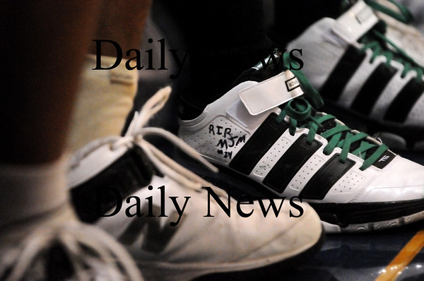 Georgetown: The Pentucket basketball team honored the memory of classmate Matt McCarthy Wednesday night by writing his initials on their sneakers. Photo by Ben Laing/Staff Photo