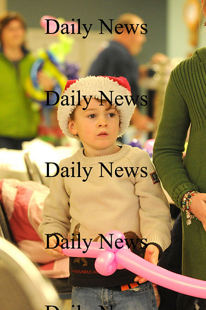 Salisbury: Cameron Doane, 5, of Salisbury, waits and watches for Santa during Saturday mornings Breakfast With Santa sponsored by the Salisbury Fire Department. Photo by Ben Laing/Staff Photo