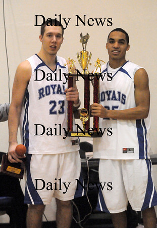 Georgetown: Georgetown co-captains Mike Messman, left, and Tyran Harrigan, right, accept the championship trophy after the Royals defeated Pentucket in the River Rivals Basketball Festival Wednesday night. Photo by Ben Laing/Staff Photo