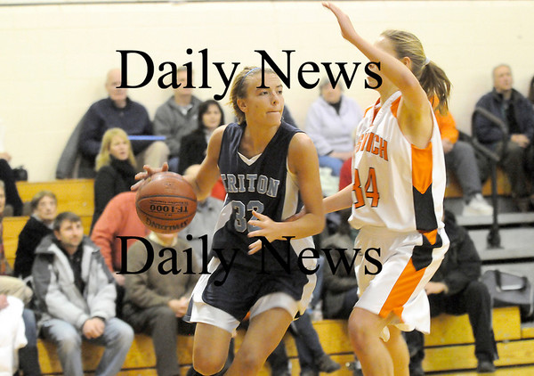 Ipswich: Triton's Jen Rock (32) looks for an open teammate during Tuesday's championship game against Ipswich. Photo by Ben Laing/Staff Photo