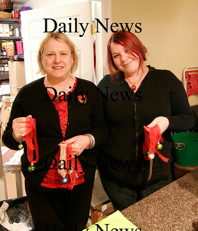 Amesbury: Deb Pagley, owner of Parke Place in Ames bury, and her daughter Lindsey, show off their Christmas themed necklaces they've created to help raise money for Our Neighbors Table. Photo by Ben Laing/Staff Photo
