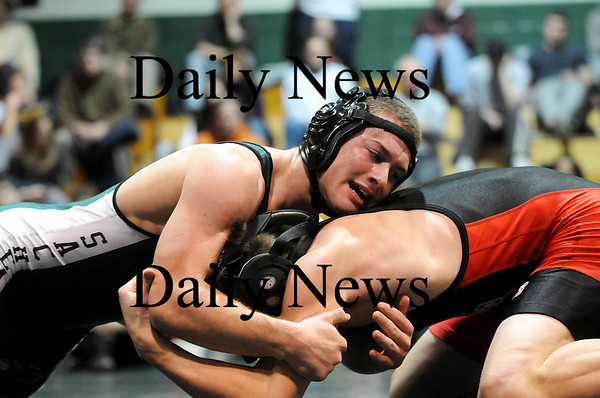 West Newbury: Pentucket's Austin Perrault grapples with his opponent from North Andover in the championship match in the 145 lbs. weight class during Pentucket's annual christmas tournament Tuesday night. Photo by Ben Laing/Staff Photo