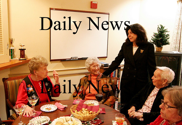 """Newburyport: Mayor-elect, Donna Holladay, speaks with a group of seniors at the Atrium Merrimack Place in Newburyport Wednesday afternoon. The seniors invited the soon to be mayor to their daily """"pub time"""". Photo by Ben Laing/Staff Photo"""