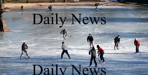 Newburyport: The recent frigid temperatures made the Mall a popular spot Wednesday afternoon, as dozens gathers to play hockey and ice skate. Photo by Ben Laing/Staff Photo