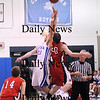 Georgetown: Mike Messman (23) of Georgetown and Tyler Lay (20) of Amesbury face off for the jump ball at the start of the second game of Monday night's double header at Georgetown High. The game was part of the inaugural River Rival Basketball Festival.