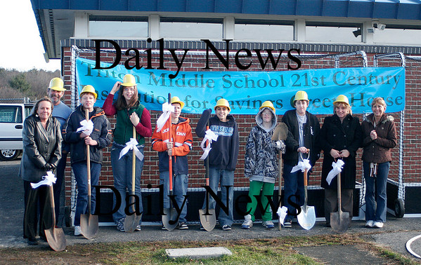 Byfield: Triton Middle School students and their teachers hold a ground breaking ceremony for their new Green Thumbs greenhouse. From left, teachers Sandy Kearney and Kurt Riese, students Jason Luneay, Justine Searle, Paul Conte, Xavier Devine, Dan Elliot, Brandon Tobin, and teachers Chris Astuccio and Dianne Desmond. Photo by Ben Laing/Staff Photo
