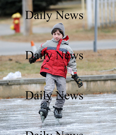 Newbury: Cole Ablow, 7, of Newbury, nearly loses his balance while ice skating on the pond at the Upper Green in Newbury Saturday morning, but managed to stay on his feet. Photo by Ben Laing/Staff Photo