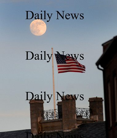 Newburyport: A full moon rises above the Custom House on Water Street in Newburyport late Wednesday afternoon. Photo by Ben Laing/Staff Photo