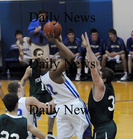 Georgetown: Neph Carmona (32) of Georgetown rises in the lane against Pentucket center Cameron Spofford (32) during Wednesday night's championship round of the River Rivals Basketball Festival. Photo by Ben Laing/Staff Photo