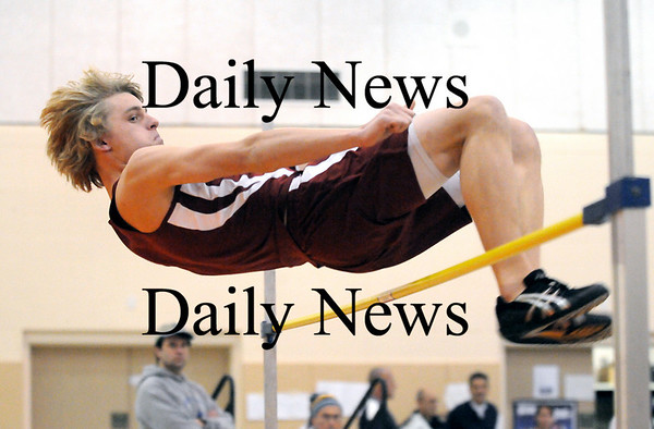 Ipswich: Newburyport's Mark Bajko clears the high jump bar during Tuesday's indoor track meet at Ipswich High. Photo by Ben Laing/Staff Photo