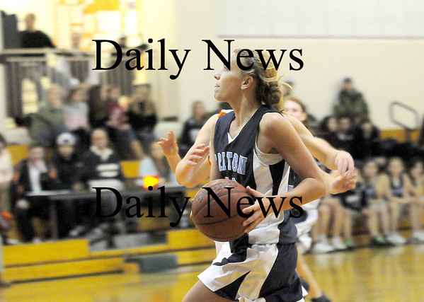 Ipswich: Triton's Jen Rock (32) drives to the hoop during Tuesday's championship game against Ipswich. Photo by Ben Laing/Staff Photo